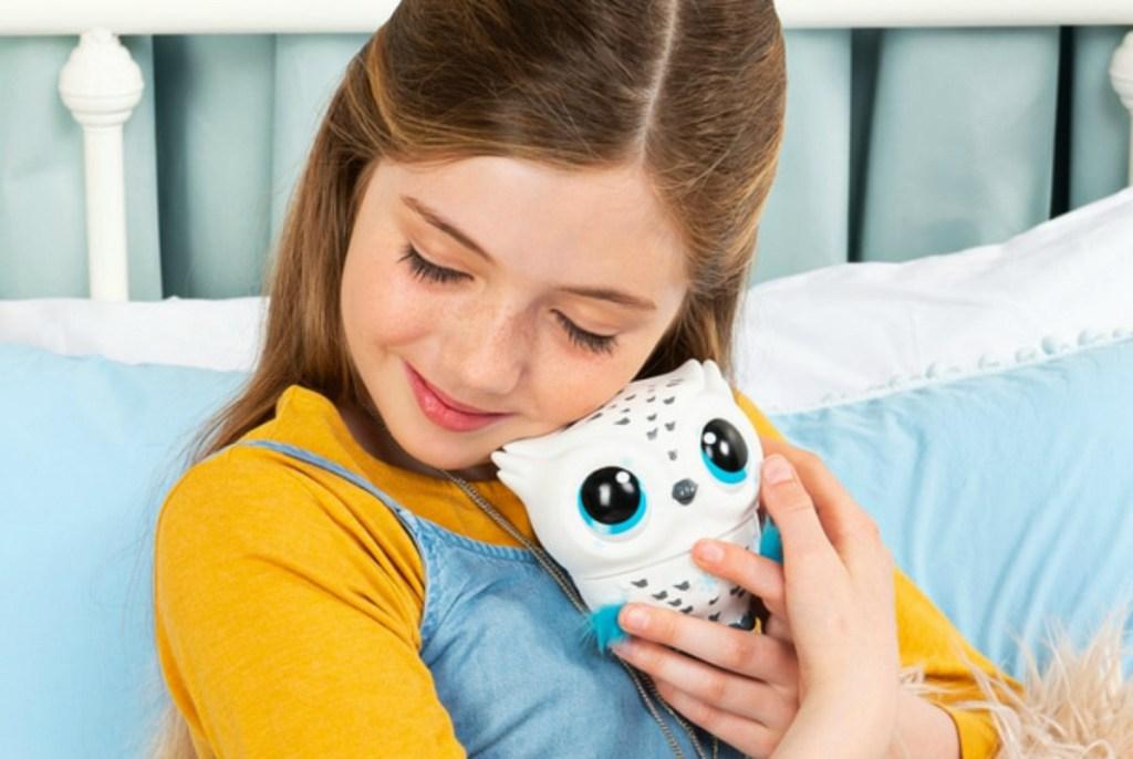 girl holding owl toy