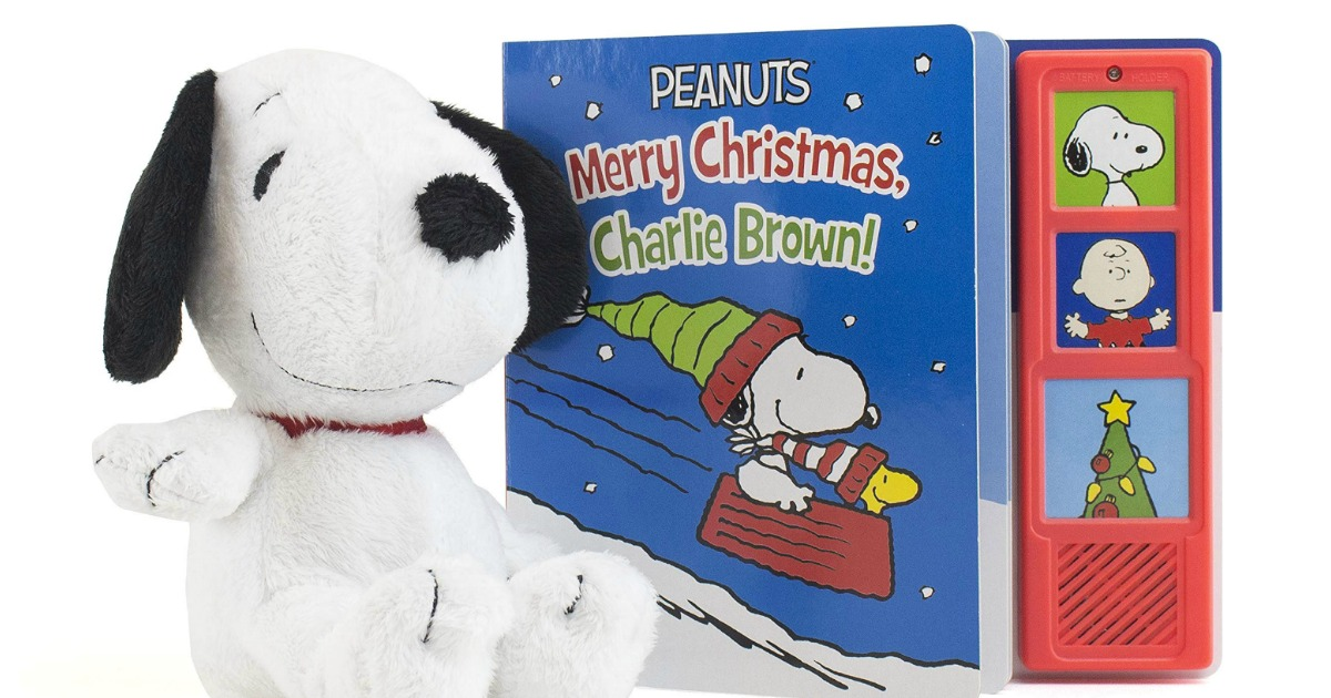 snoopy plush toy next to a Merry Christmas Charlie Brown book