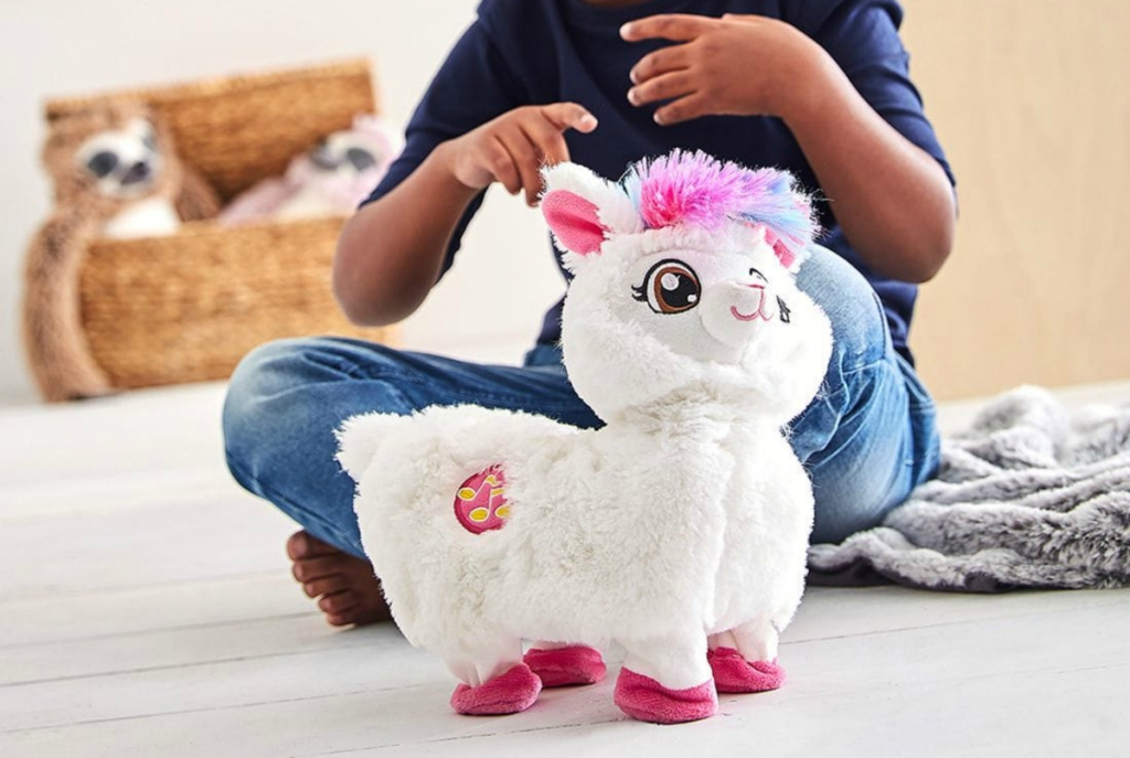 kid playing with white llama toy