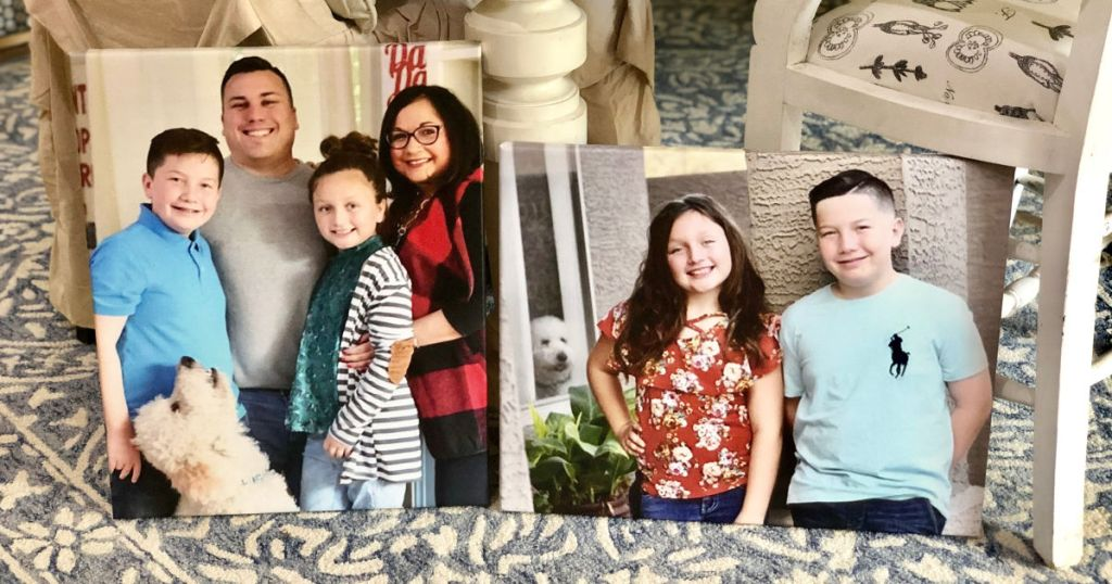 Linas family in two photo canvases leaned up against table