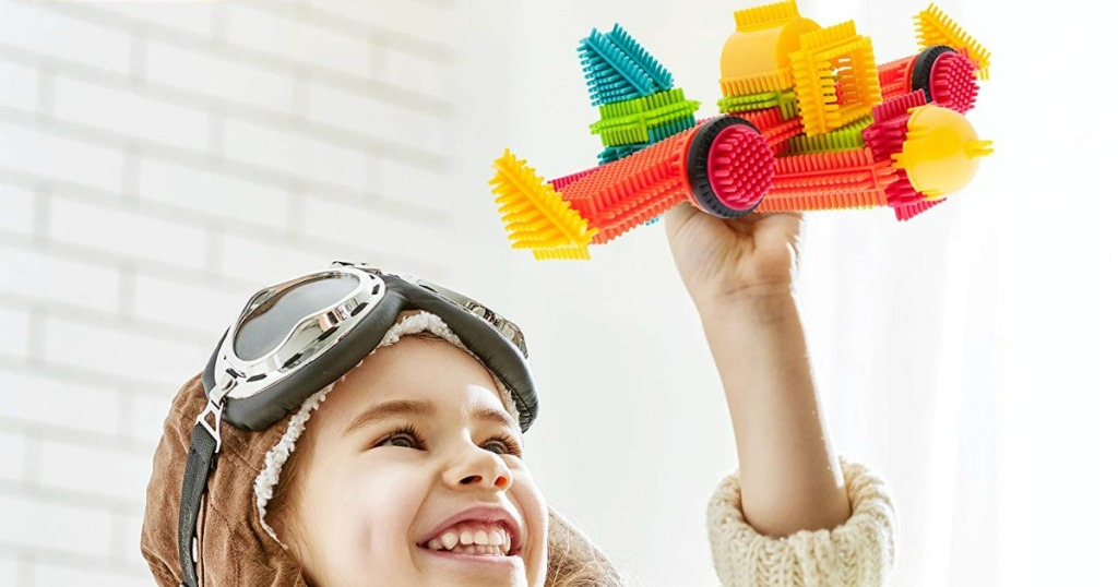 boy playing with Bristle Blocks plane