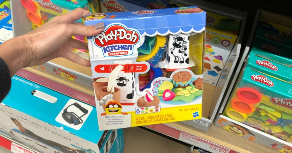 Woman holding Play-Doh Kitchen Creations in ALDI store