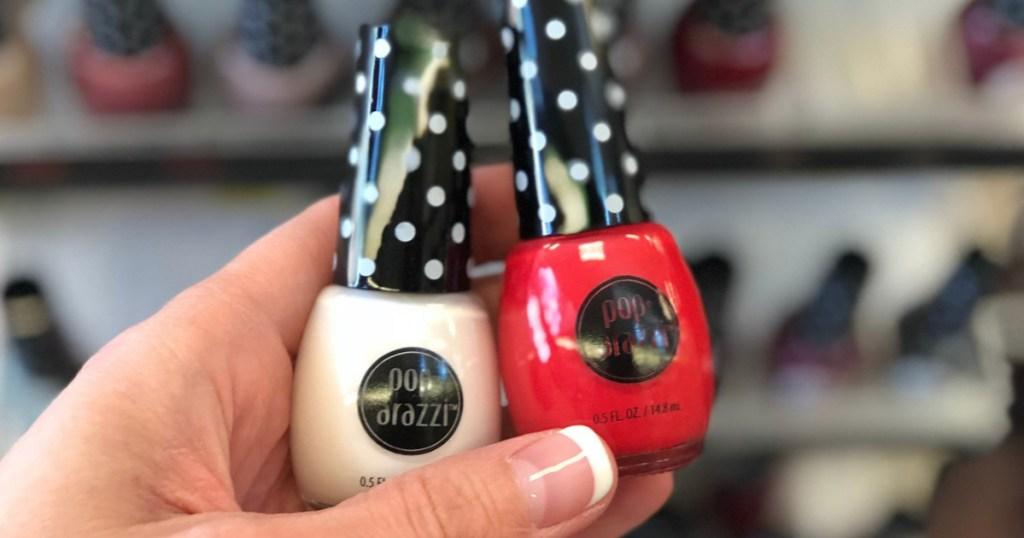 Hand holding Pop·arazzi Nail Polish