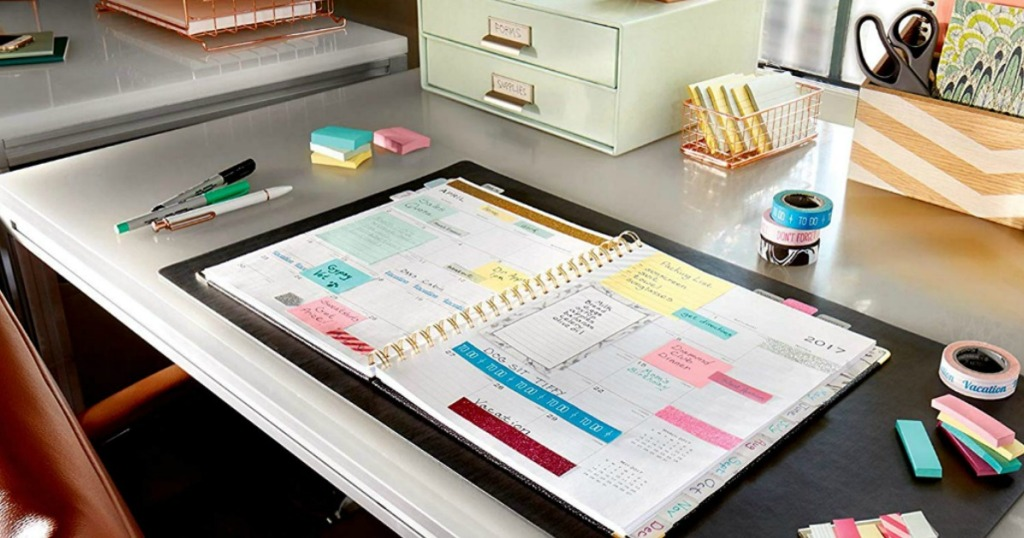 planner with post-it notes on it