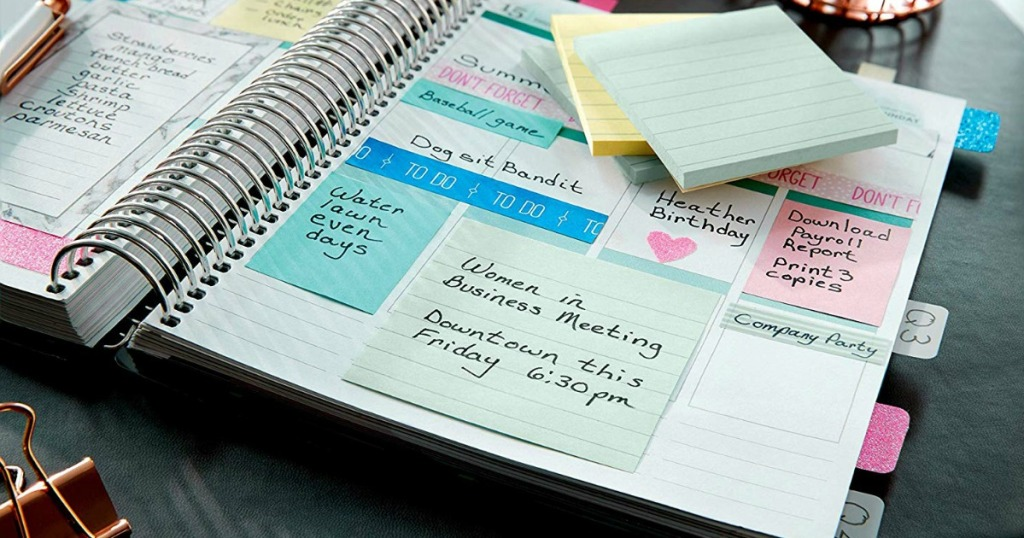 post-its sticky notes in pastel colors on a planner