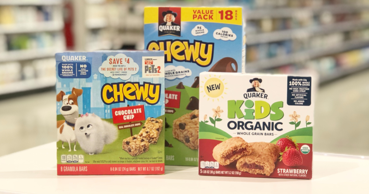 boxes of Quaker Chewy Bars and Kids Organic bars on a table in store
