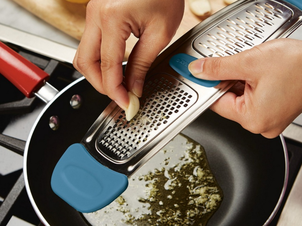 Hand grating garlic with a Rachael Ray Metal Grater