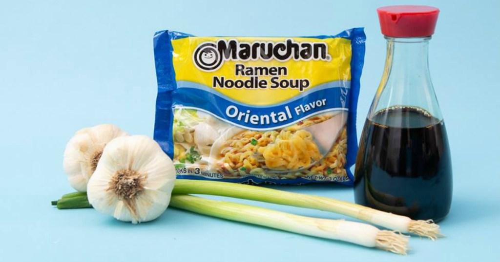 Maruchan Ramen Oriental Flavor pack near garlic, green onions and soy sauce