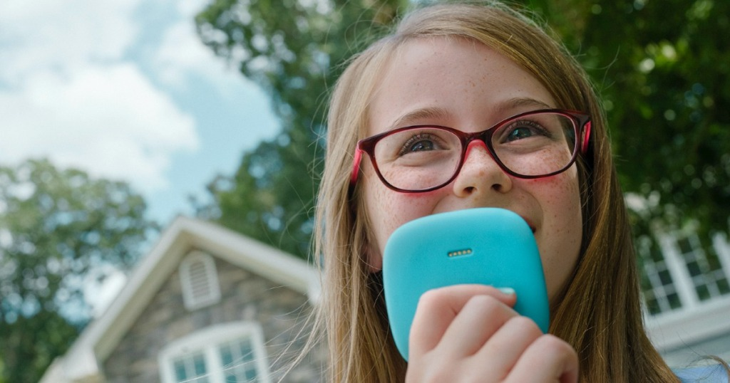 Girl holding blue relay