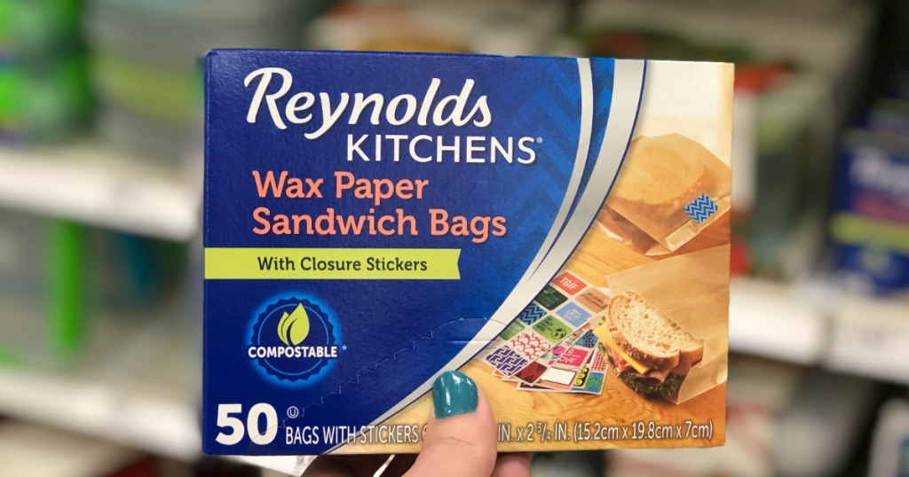 hand holding up Reynolds Wax Paper Sandwich Bags in box