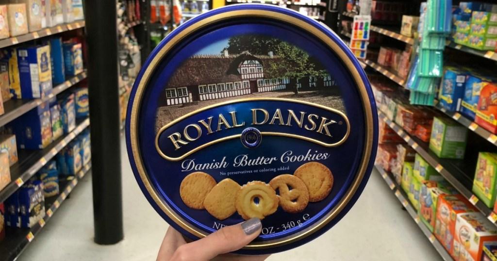 Tin of danish butter cookies in store in hand