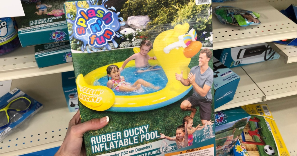 woman holding rubby ducky inflatable pool box