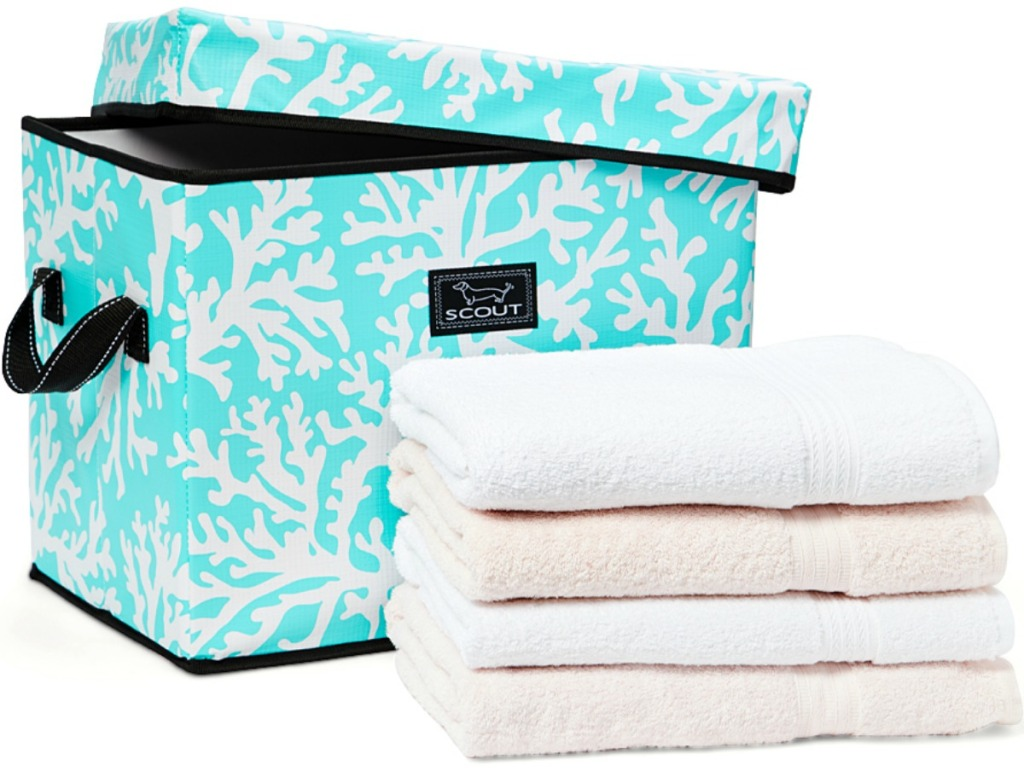 SCOUT Bags brand bin with cover in coral and blue print with stack of towels