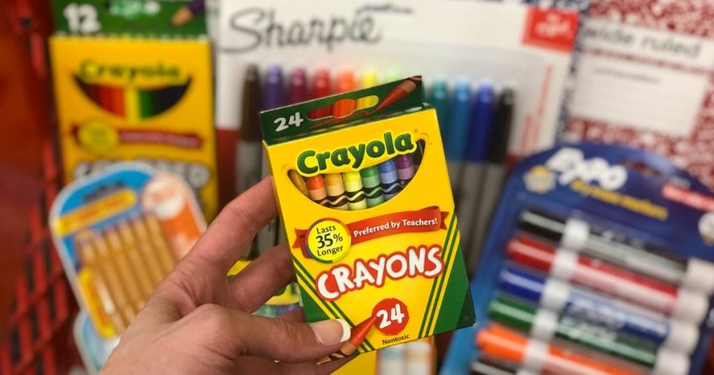 Woman holding Crayola Crayons