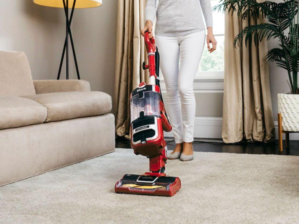 woman vacuuming floor with Shark Navigator Lift-Away Speed Zero-M Self-Cleaning Brushroll Upright Vacuum