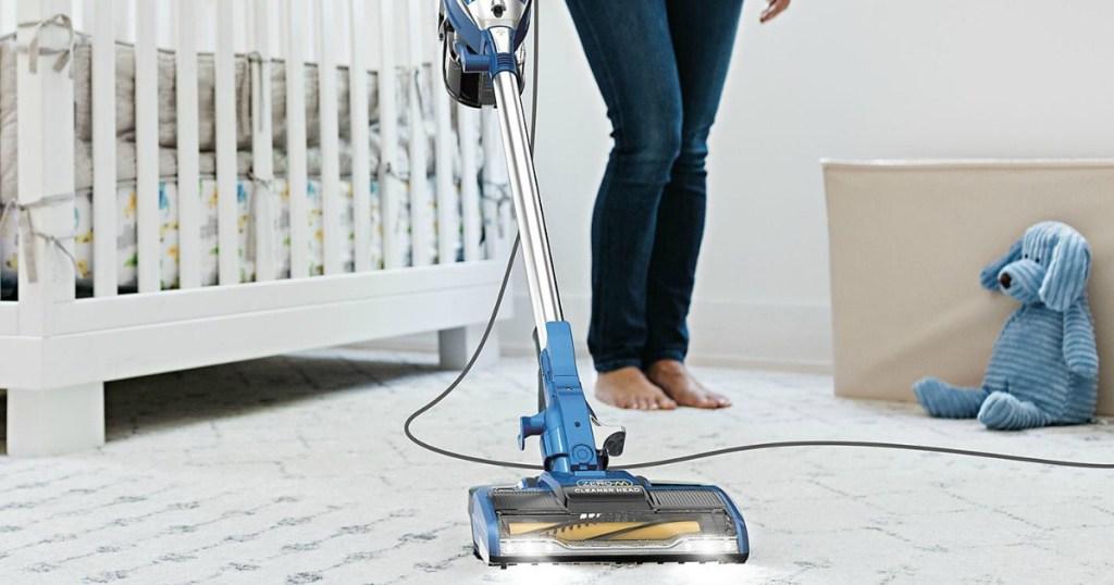 Stick Vacuum Cleaner Shark-brand corded stick vacuum being used in nursery