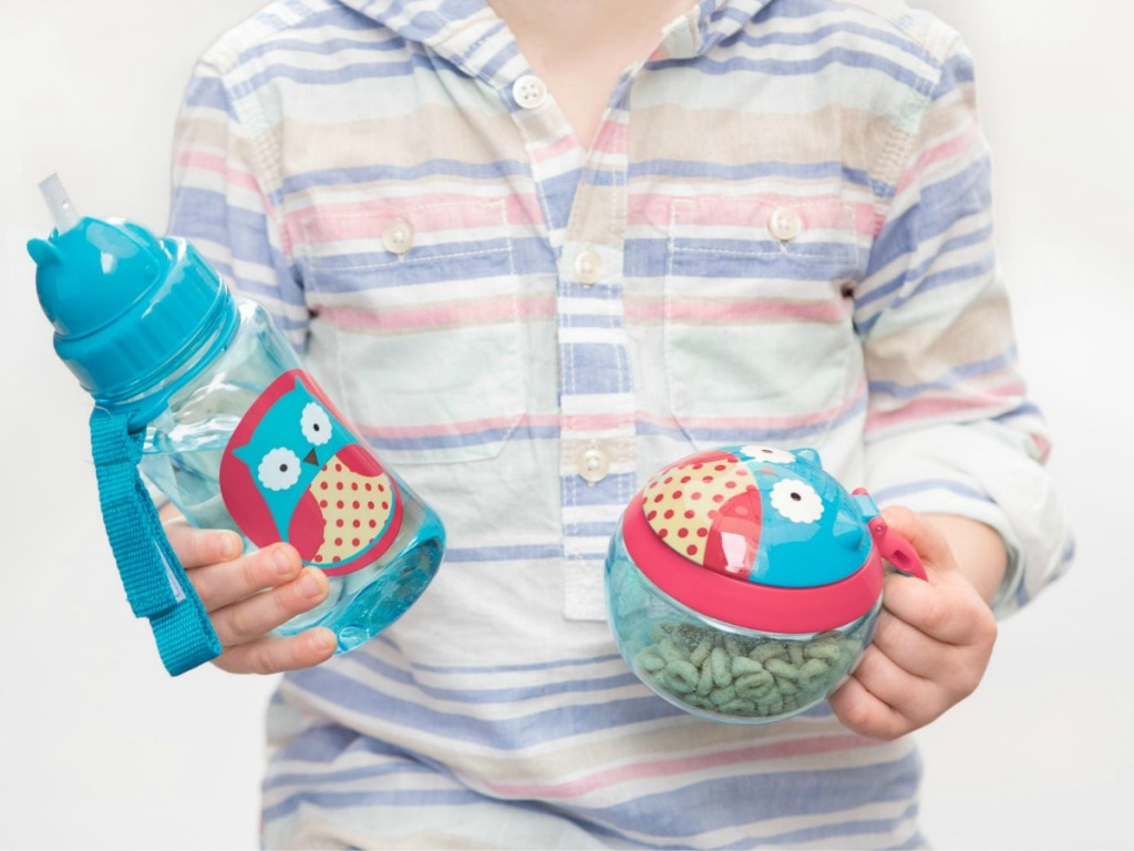 boy holding Skip Hop Owl Snack Cup and water bottle