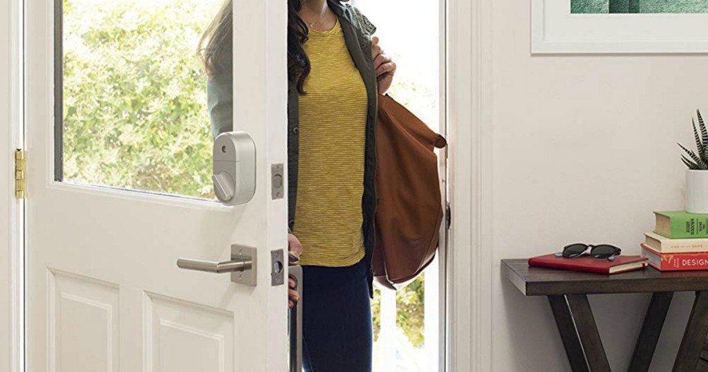 lady walking into her home with August Smart lock