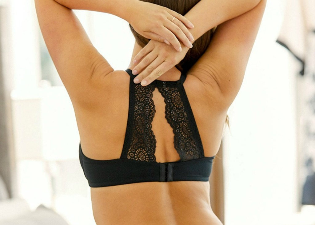 back view of woman wearing black lace bralette