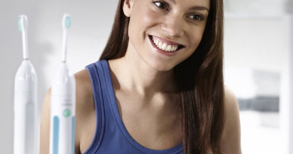 woman with sonicare essence toohbrush