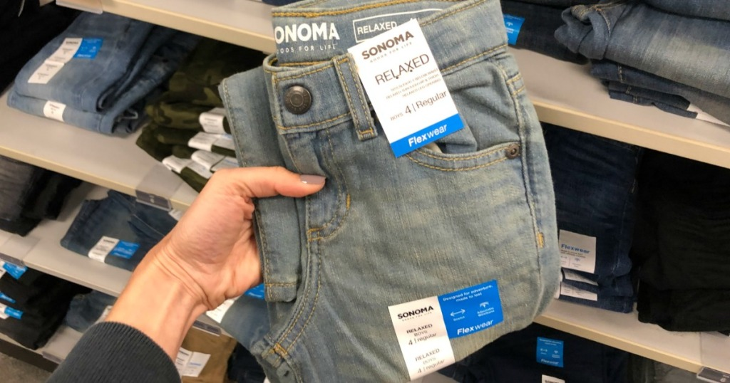 Sonoma Boys Jeans being held by a woman's hand