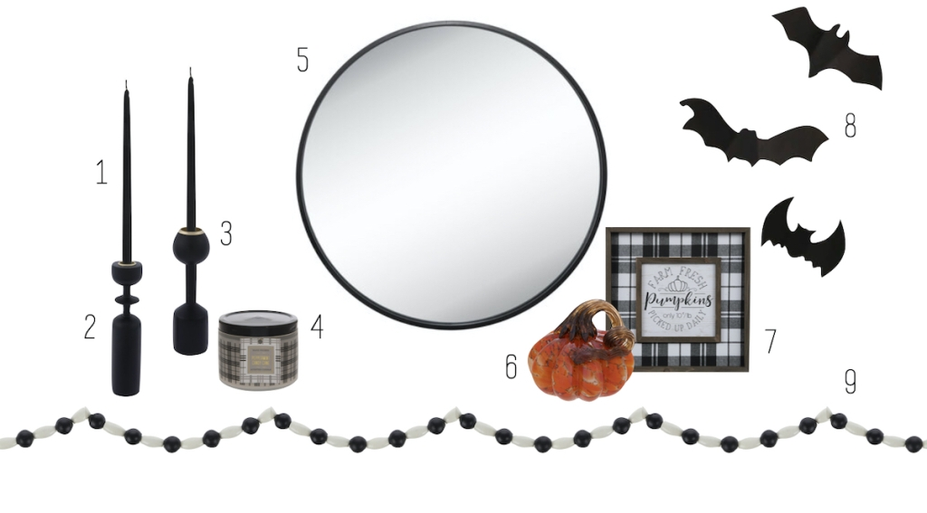 mirror and other various halloween and fall decor on white background