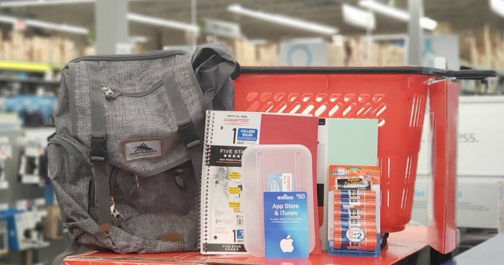 Staples back to school items next to shopping basket