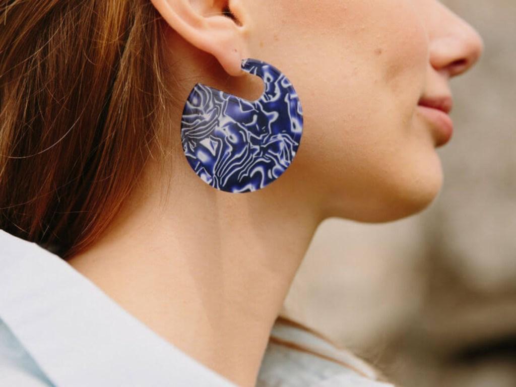 Woman wearing Starfish Project Winnie Earrings