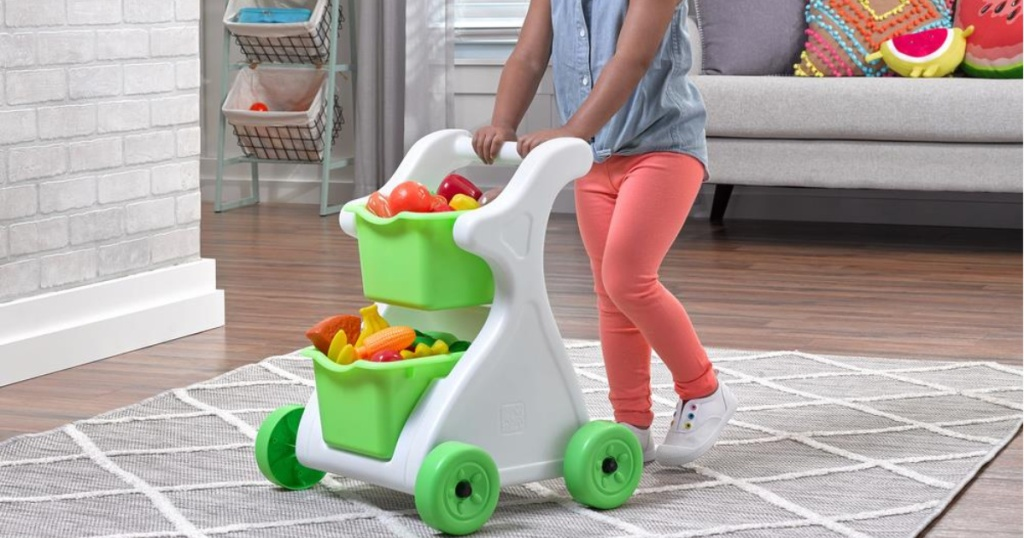 girl playing with step2 modern mart shopping cart