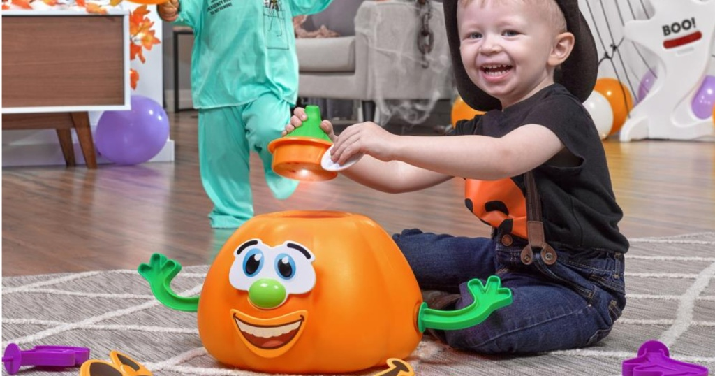 boy playing with step2 my first jack o lantern toy