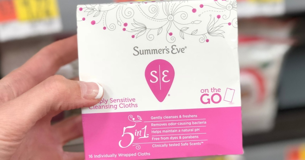 Hand holding Summer's Eve Cleansing Cloths