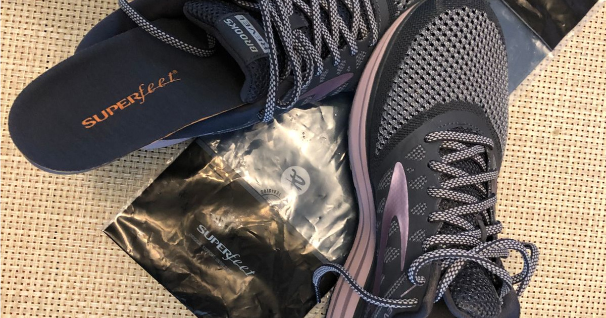 superfeet charcoal insoles sticking out of a pair of sneakers