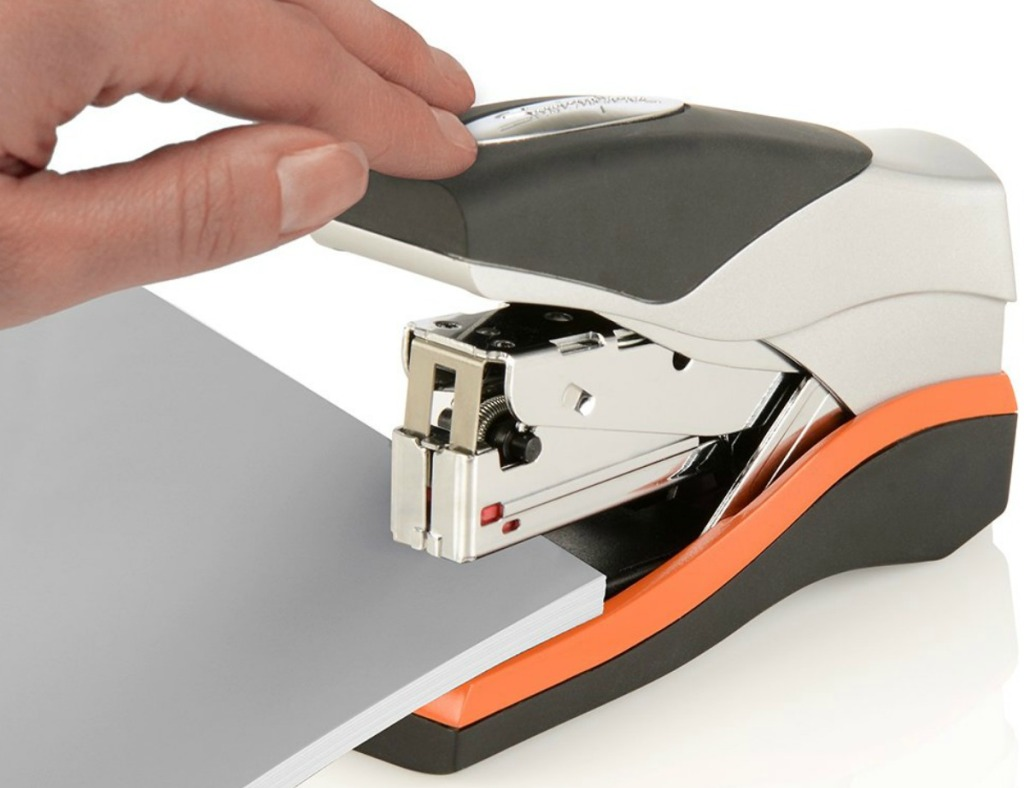 Silver and Orange compact stapler in use
