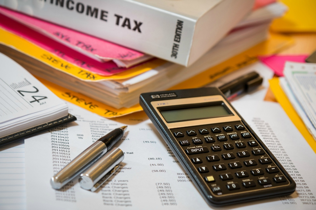 calculator, pen and tax documents