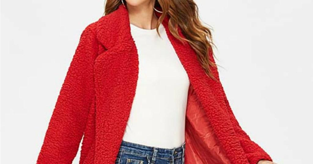Woman wearing red teddy coat