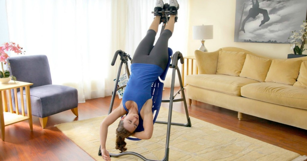 woman laying on inversion table