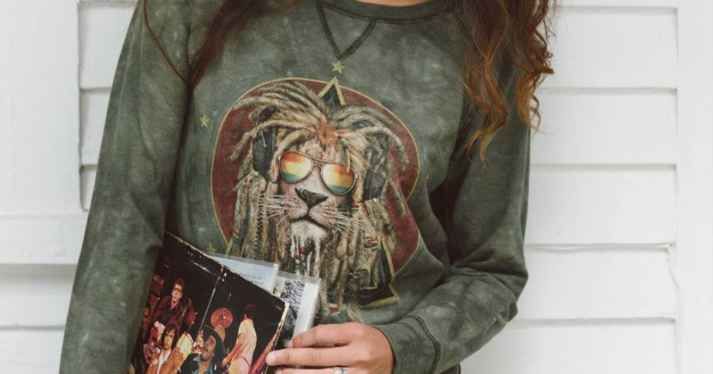 woman wearing the mountain rasta lion pull over