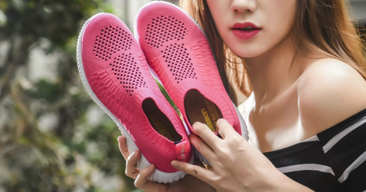 Woman holding pink pair of Tiosebon Slip-On Shoes
