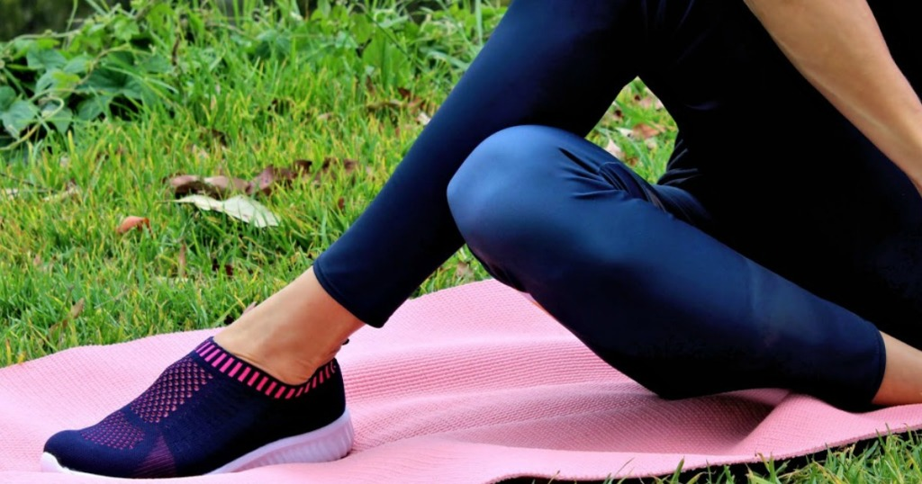 woman wearing blue and pink slip on shoes