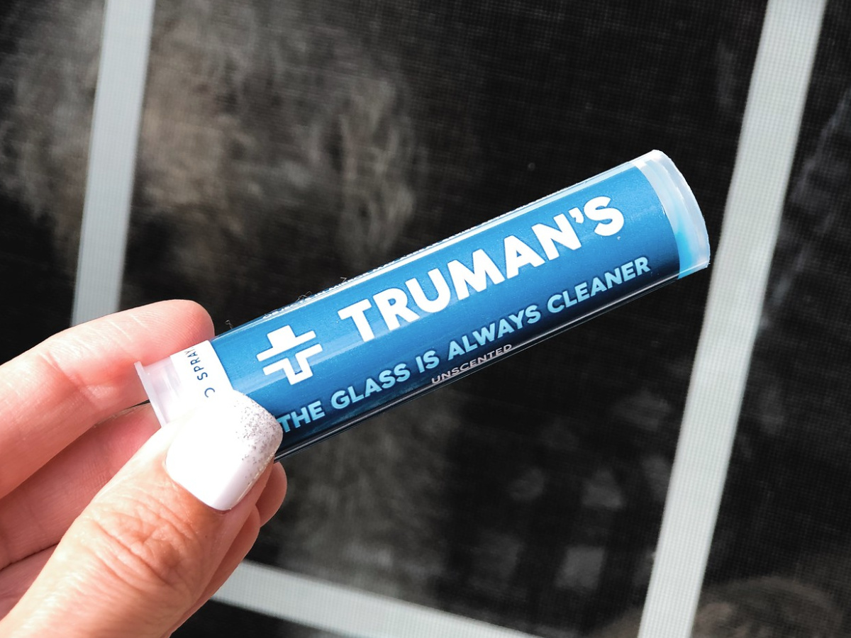 Female hand holding Truman all-natural glass cleaner