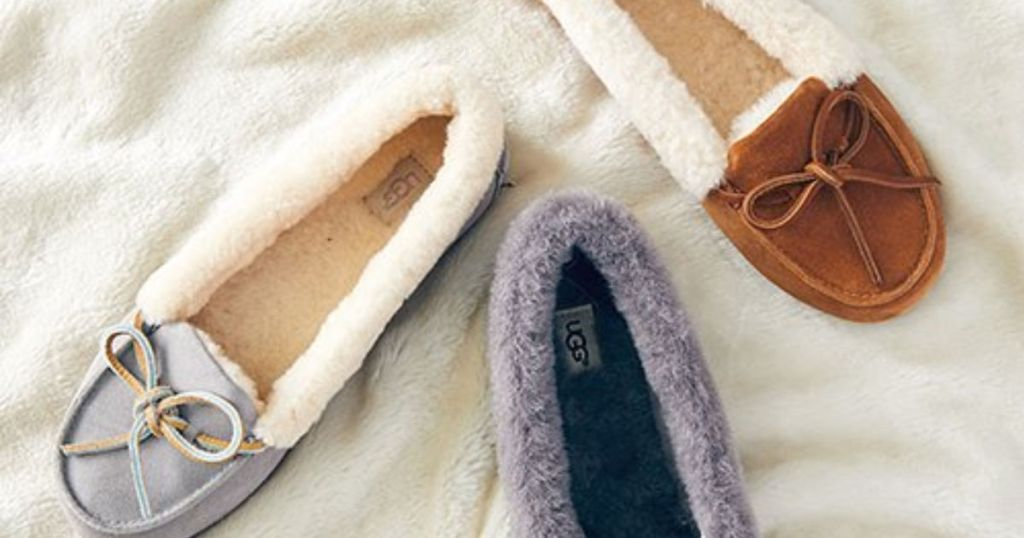 Ugg Solano Slippers in grey, blue, and brown on plush blanket