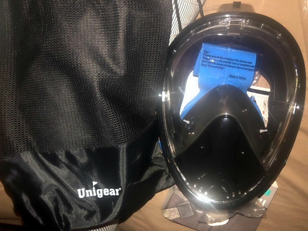 black Unigear snorkel mask with bag