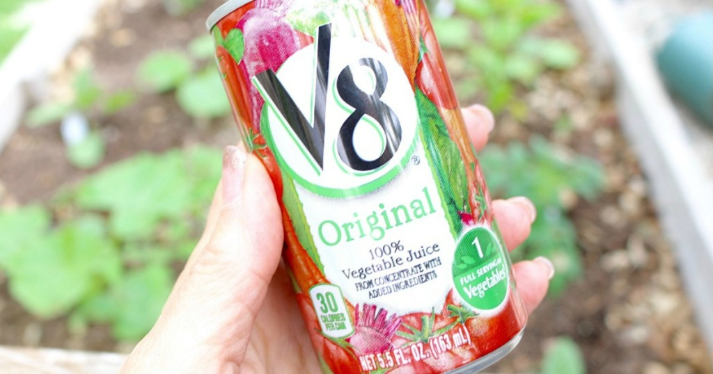 lady holding V8 Juice
