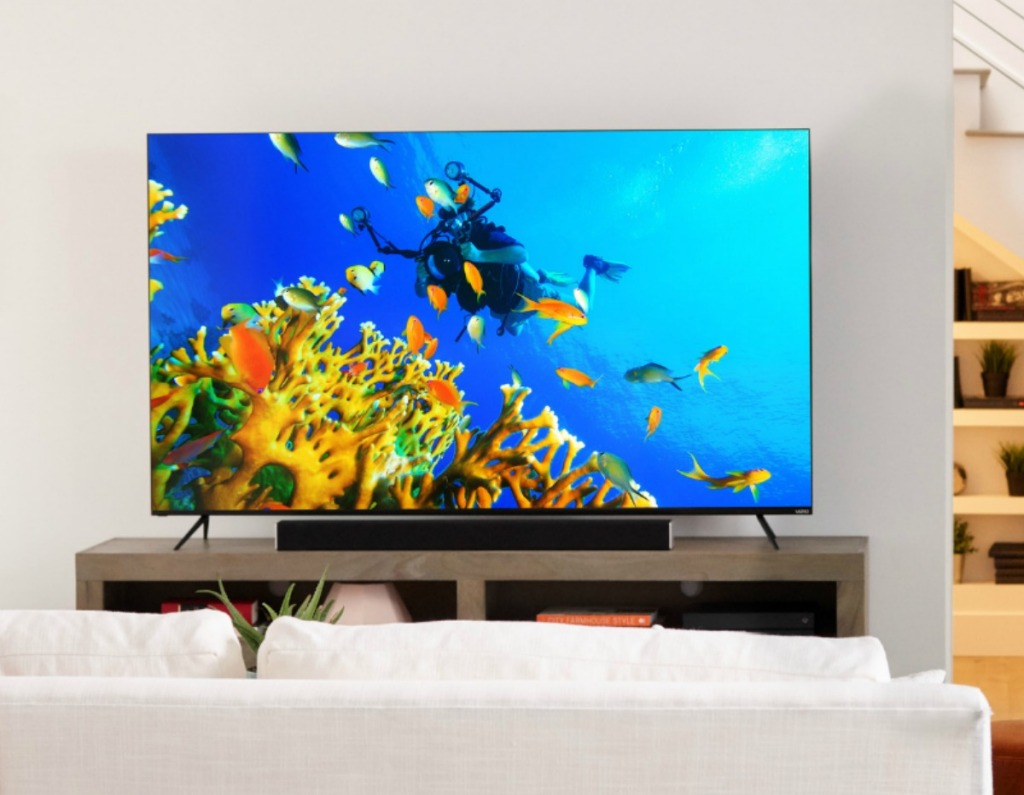 Vizio Smart TV in living room set up on entertainment stand with underwater scene