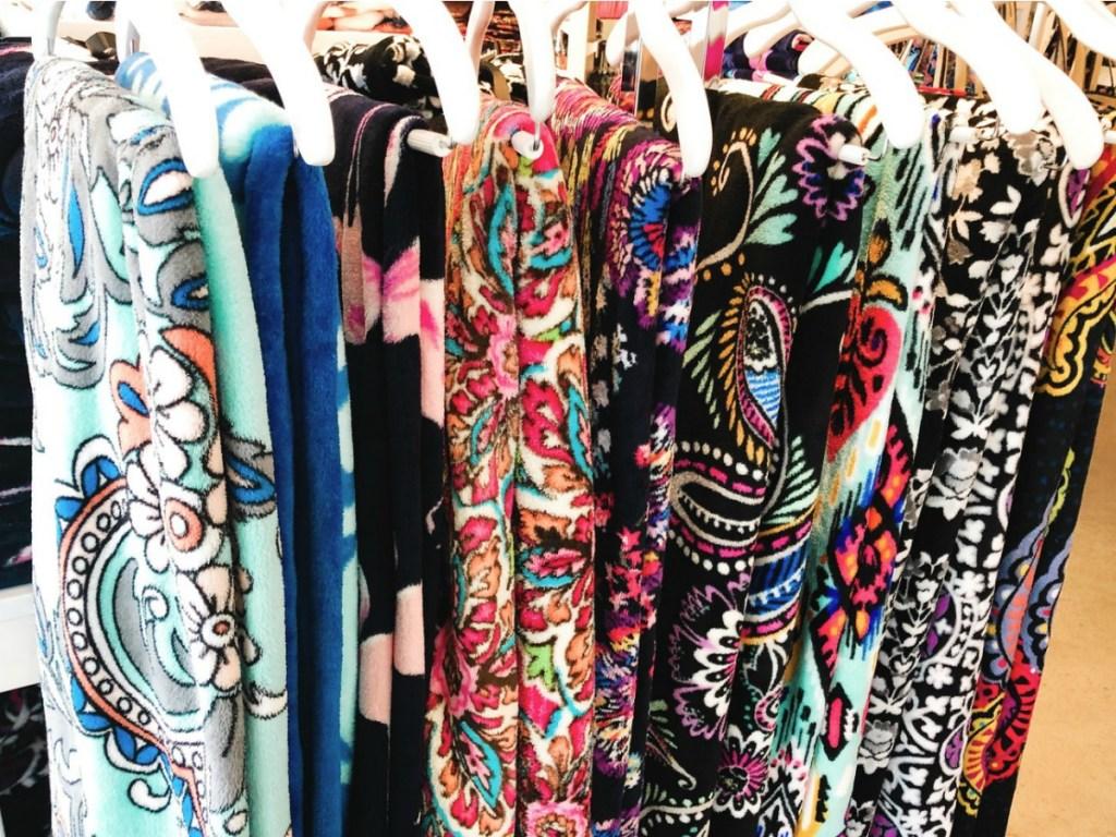 Vera Bradley Throw Blankets on hangers at store