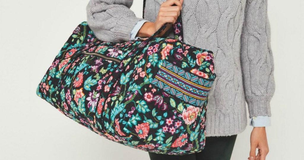 Vera Bradley Travel Duffel on woman's shoulder