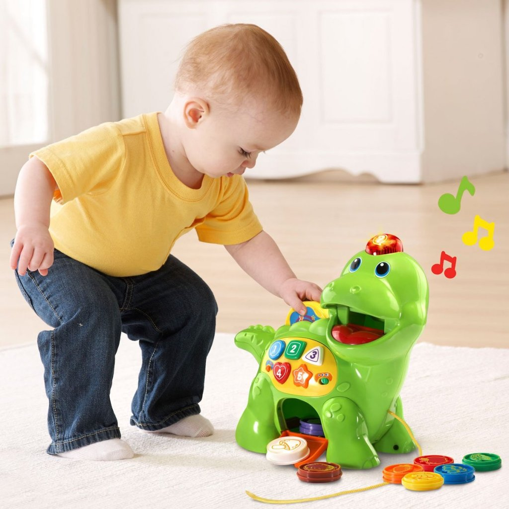 kid playing with Vtech Dino