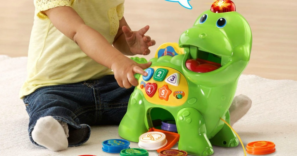 child playing with toy dinosaur