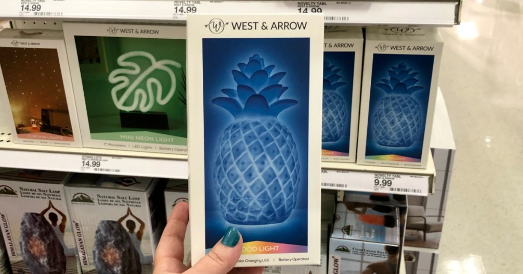 hand holding pineapple lamp