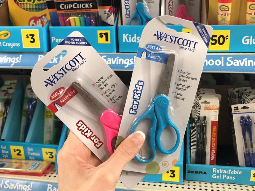 Hand holding Westcott Kids Scissors at Dollar General